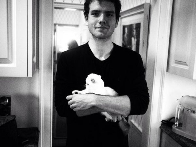 Austin Swift with his cat as seen in August 2014