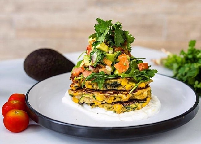 Corn and zucchini fritters with avocado salsa