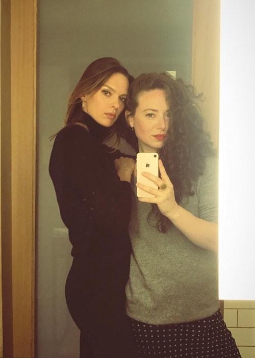 Elise Crombez (Left) in a mirror selfie with Chloe Hartstein in July 2018