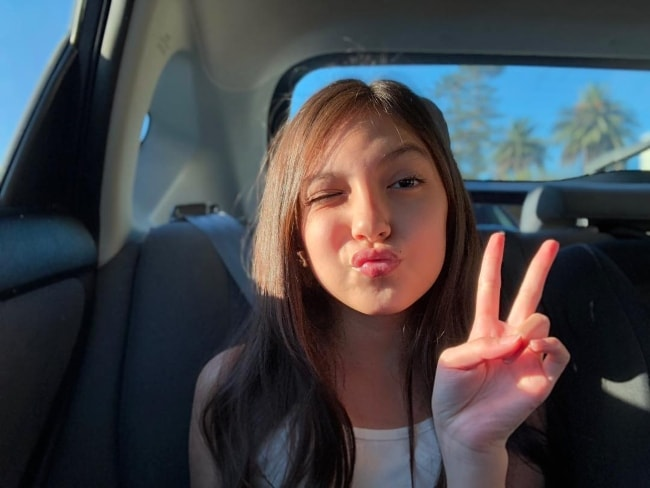 Elle Paris Legaspi posing inside a car in October 2018