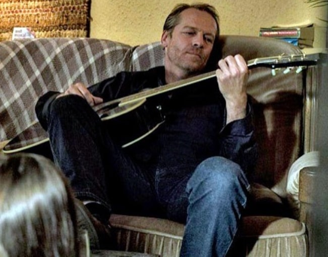 Iain Glen as seen with his guitar