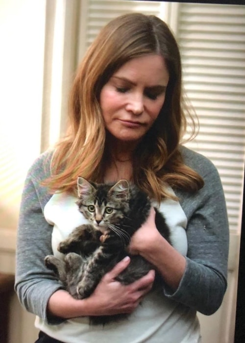 Jennifer Jason Leigh with a cat