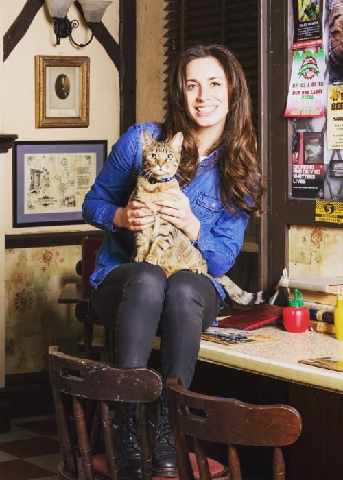 Julia Goulding posing with her cat