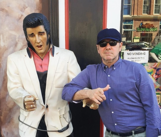Kevin Spacey posing with a Elvis Presley statue in April 2016