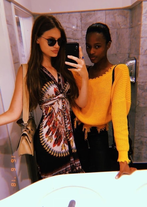 Faretta taking a mirror selfie with Mayowa Nicholas in June 2018
