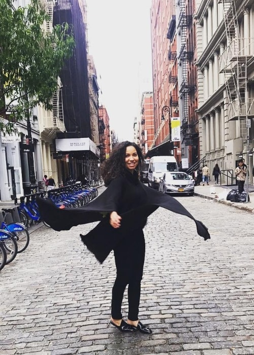 Jurnee Smollett-Bell posing happily in the middle of the street