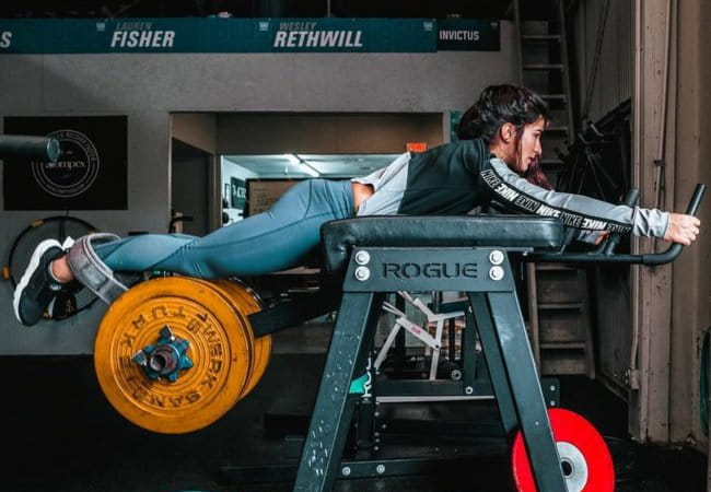 Lauren Fisher exercising on a reverse hyper machine as seen in January 2019