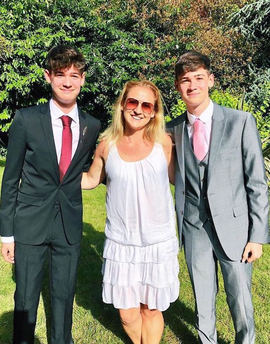 Max and Harvey with their mother Sara in their prom dress in June 2019