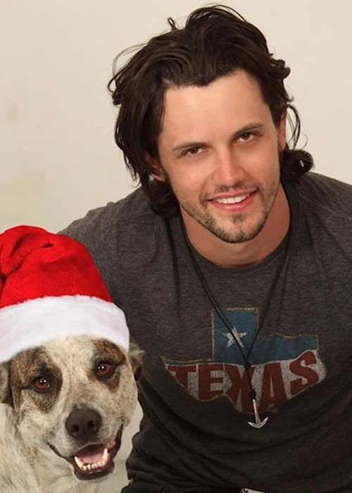 Nathan Parsons with his Favourite non-human Charlie as seen on his Twitter Profile