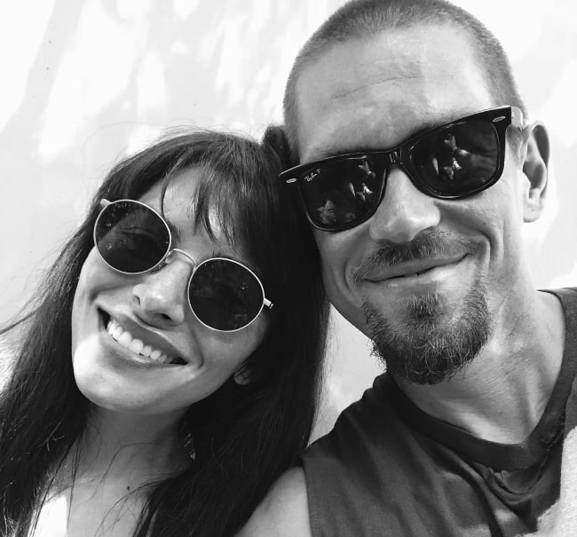 Steve Howey in a black-and-white selfie with Sarah Shahi in July 2018