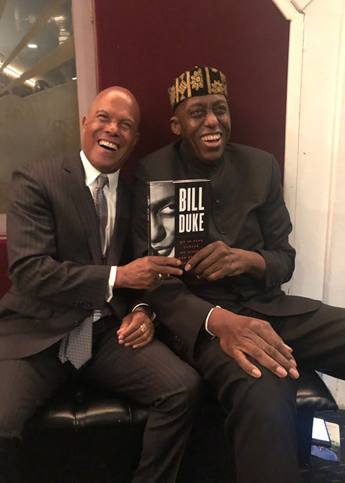Bill Duke with Michael Beck Sharing his Autobiography with Him as seen on his Twitter Profile in February 2019