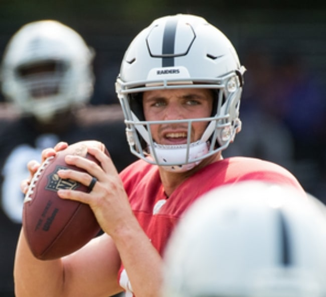 Derek Carr as seen while throwing a pass during The Raiders' practice session at their training facility in the Napa Valley, California in August 2018