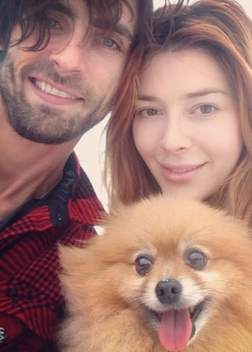 Elena Satine as seen in a picture with her husband Tyson Ritter and pet dog in May 2018