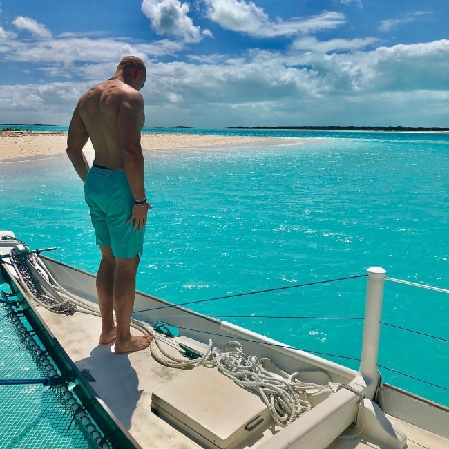 Jimmy Graham posing shirtless in April 2018
