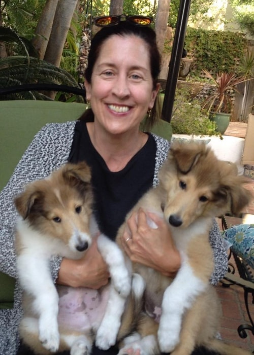 Mary Scheer as seen in a picture with two little puppies in April 2017