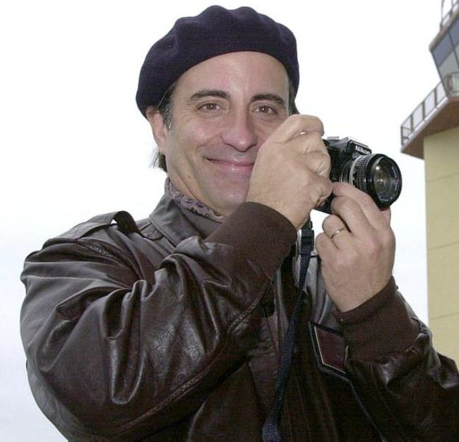 Andy Garcia taking a picture at the Incirlik Air Base in Turkey in December 2001