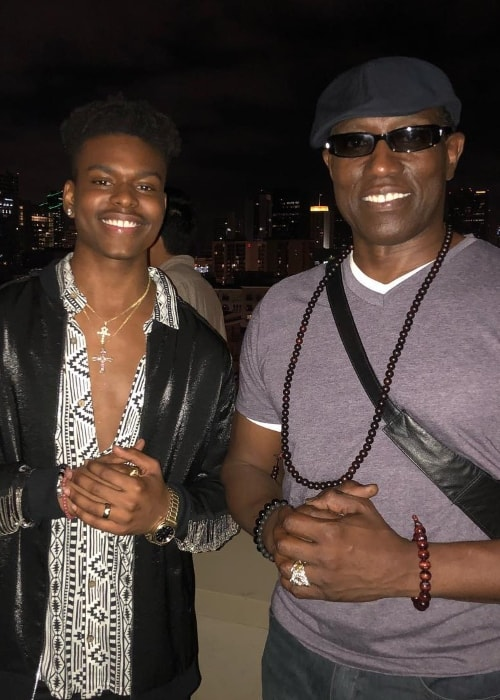 Aubrey Joseph (Left) as seen while posing with Wesley Snipes in July 2018
