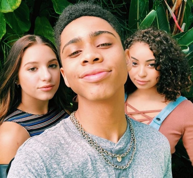 Bryce Xavier as seen while taking a selfie with Devenity Perkins (Right) and Kenzie in December 2018