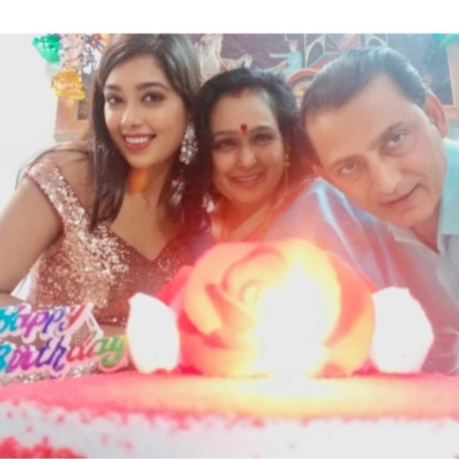 Digangana Suryavanshi as seen in a picture celebrating her mothers birthday alongside her father in February 2019