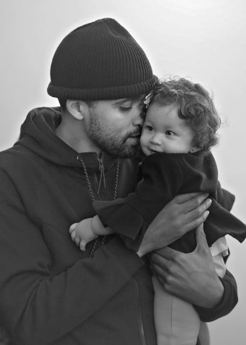 JRDN in a black-and-white picture with his daughter