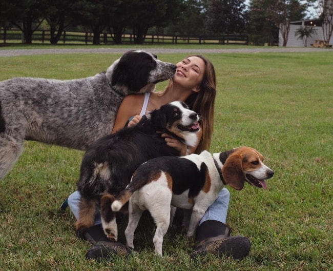 Lauren Rhoden as seen while enjoying her time cuddling with her four-legged friends in Culpeper County, Virginia in August 2018
