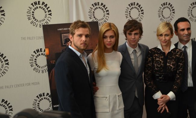 Max Thieriot alongside his castmates from Bates Motel
