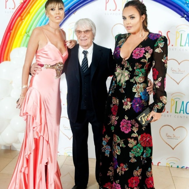 Petra Ecclestone (Left) as seen while posing with her father and older sister at the launch event of Petra's foundation