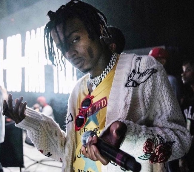 Playboi Carti pictured while holding a mic