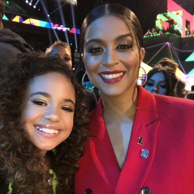 Scarlet Spencer (Left) as seen while posing with the famous YouTuber, Lilly Singh, during a Nickelodeon party in March 2019
