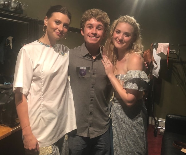 Sean Giambrone (Center) as seen while posing with the members of the pop rock duo, 'Aly & AJ', in Vancouver in June 2018