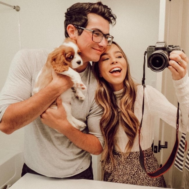 Sierra Furtado as seen while taking a mirror selfie with Alex Terranova and their Cavalier King Charles Spaniel named Penny in October 2018