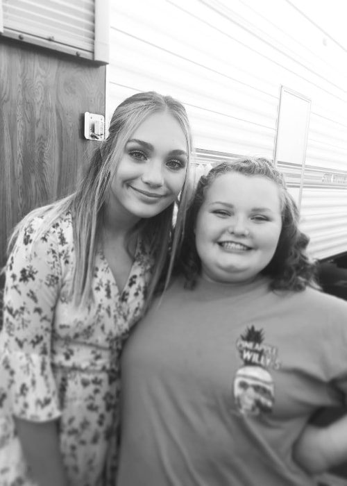 Alana Thompson as seen in a black-and-white picture while posing with actress, dancer, and model, Maddie Ziegler