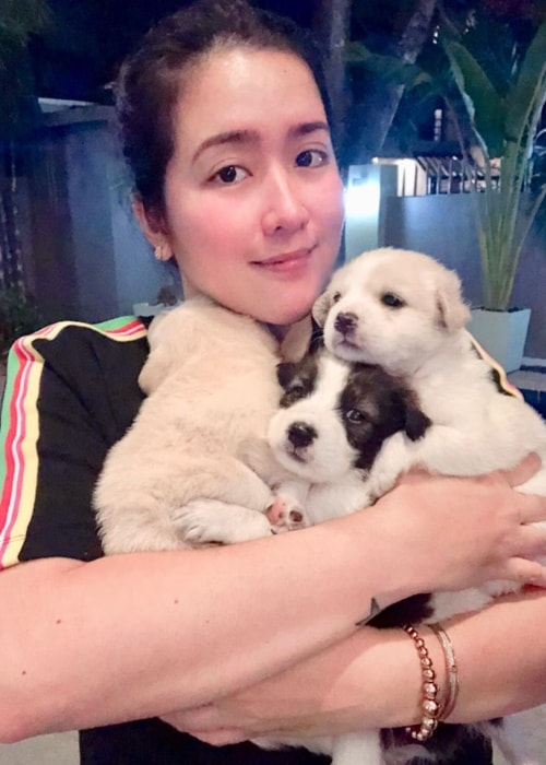 Angeline Quinto as seen while posing for an adorable picture with three puppies in May 2019