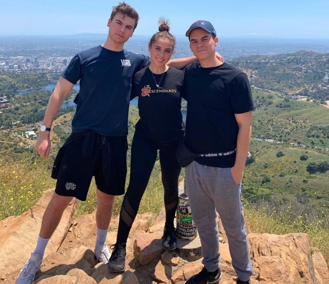 Brenna D'Amico as seen while posing with Preston Thompson (Right) and Christian Weissmann at Wisdom Tree Lake Hollywood in Los Angeles, California in May 2019