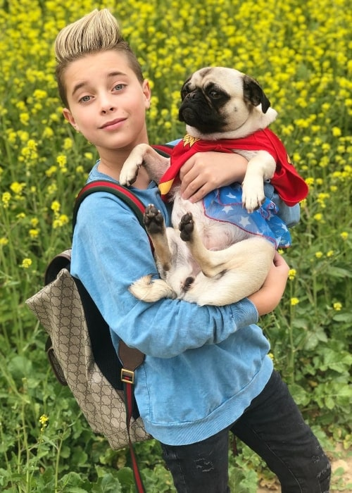 Gavin Magnus as seen while posing with his pug named Zoey in Los Angeles, California in February 2019