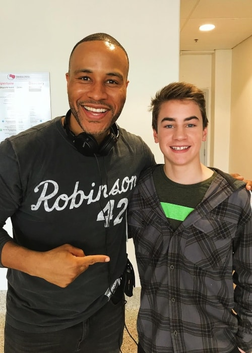 Isaac Kragten (Right) as seen while posing with the producer of the movie 'Breakthrough', DeVon Franklin, in April 2018