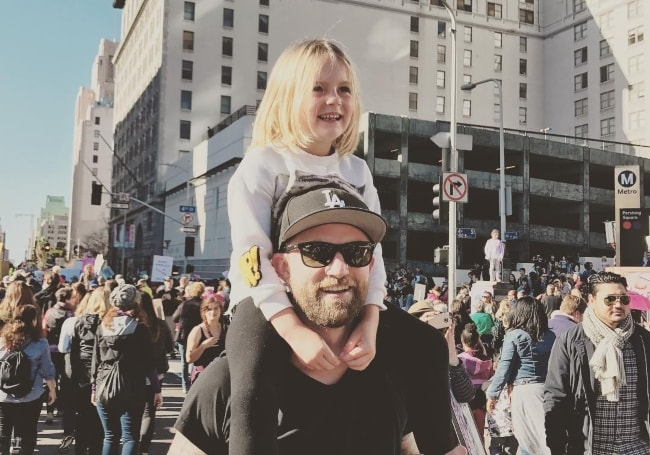 Joel Little as seen while carrying his daughter on his shoulders during the Women's March in January 2017