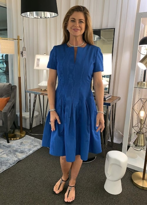 Kathy Ireland as seen while posing for a picture in a beautiful blue dress at World Market Center Las Vegas in Las Vegas, Nevada, United States in January 2019