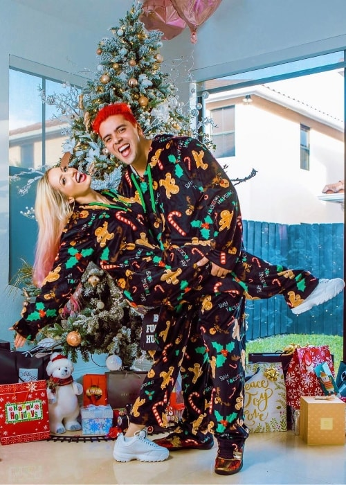Katie Angel as seen while posing for a Christmas picture with her husband, ItsOsoTV, in December 2018