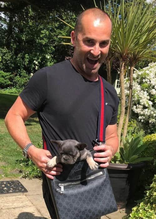 Louie Spence with his dog as seen in May 2019