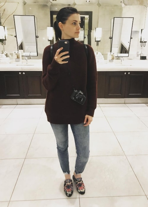 Meganne Young as seen while taking a bathroom mirror selfie in The Grove, Los Angeles, California in May 2018