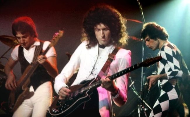 Queen band members Brian May, Freddie Mercury, and John Deacon performing in Connecticut in 1977