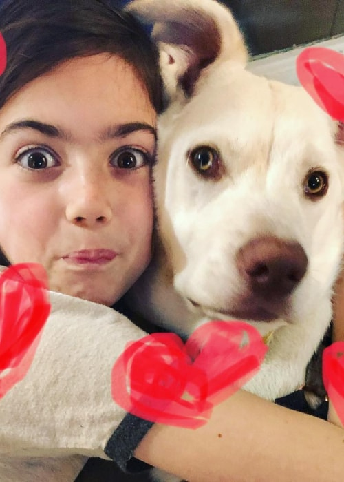 Abby Ryder Fortson as seen in a picture with her pet dog Thomas in February 2019