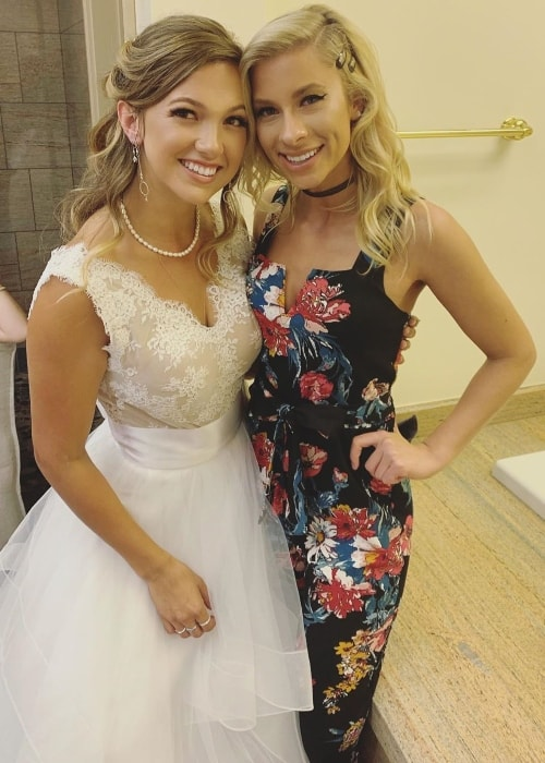 Andie Case (Right) as seen while posing for a picture with her friend, Clarissa Heitz, on her wedding day in March 2019