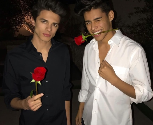 Andrew Davila as seen wearing a white shirt and posing for the camera alongside his friend, Brent Rivera, in February 2019