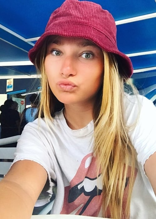 Ava August as seen pouting while taking a selfie wearing a hat in Oranjestad, Aruba in April 2019