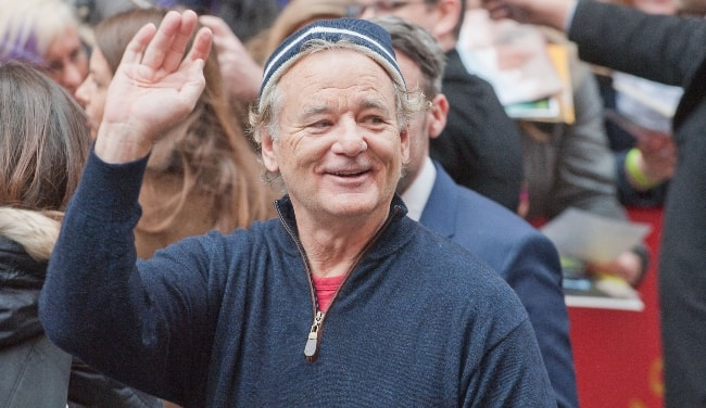 Bill Murray as seen while waving during the press conference of 'The Monuments Men' at the Berlinale 2014