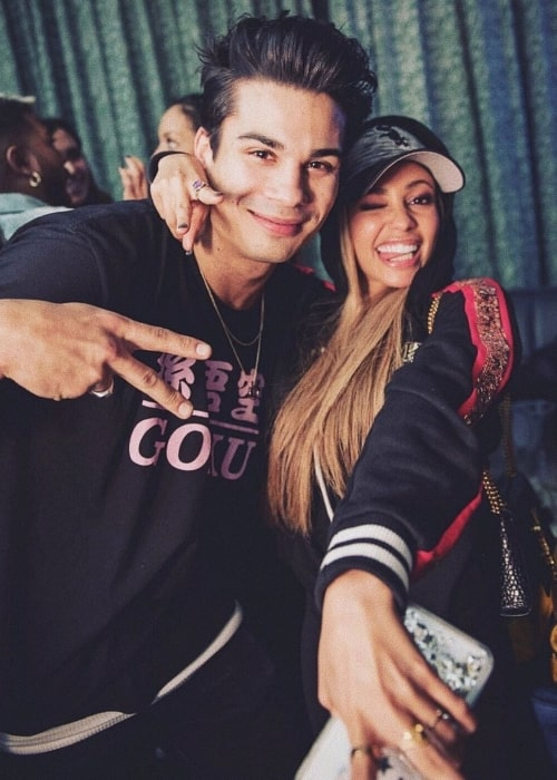 Drew Ray Tanner as seen while posing for a picture with his dear friend, Vanessa Morgan