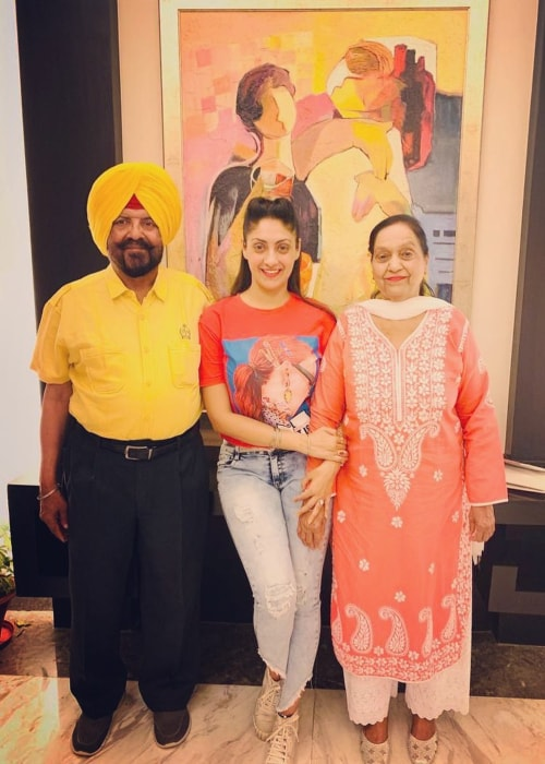 Gurleen Chopra as seen in a picture with her father Harjit Singh Chopra (On The Left) and mother Anup Chopra (On The Right) at James Hotel, Chandigarh in June 2019