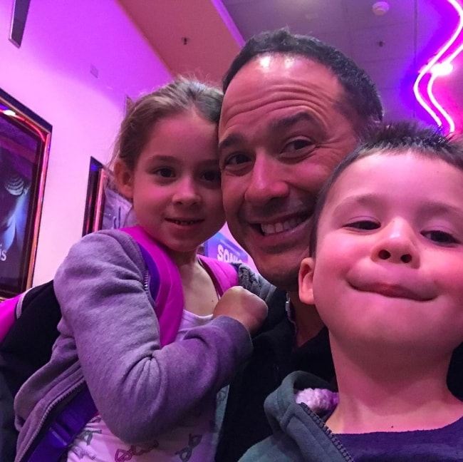 Joe Nieves as seen in a picture with his kids while watching a movie in May 2019